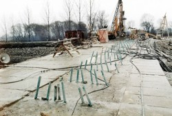 Grouting field for strengthening of overburden walls for driving an underground collector