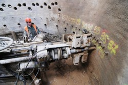 Drilling boreholes for compensation grouting carried out from a shaft using a mining drilling rig; the Královopolské Tunnels in Brno