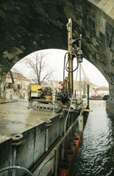 Final sealing of a building cofferdam made of sheet piles with a jet grouting cut-off; reconstruction of the pillars no. 8 and 9 of the Charles Bridge in Prague