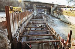 A strutted cofferdam made of sheet piles fitted into pre-excavated trenches filled with clay-cement mixtures. An elevated road cantilevered over the Bílina River in Ústí nad Labem