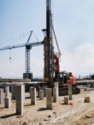Prefabricated reinforced concrete piles driving at the construction site of the express way H5 Koper-Lucija in Slovenia