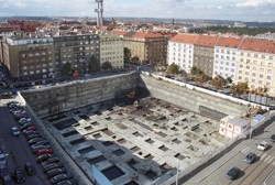 An extensive foundation pit secured by anchored rider bracing with shotcretes; the Luxembourg Plaza in Prague
